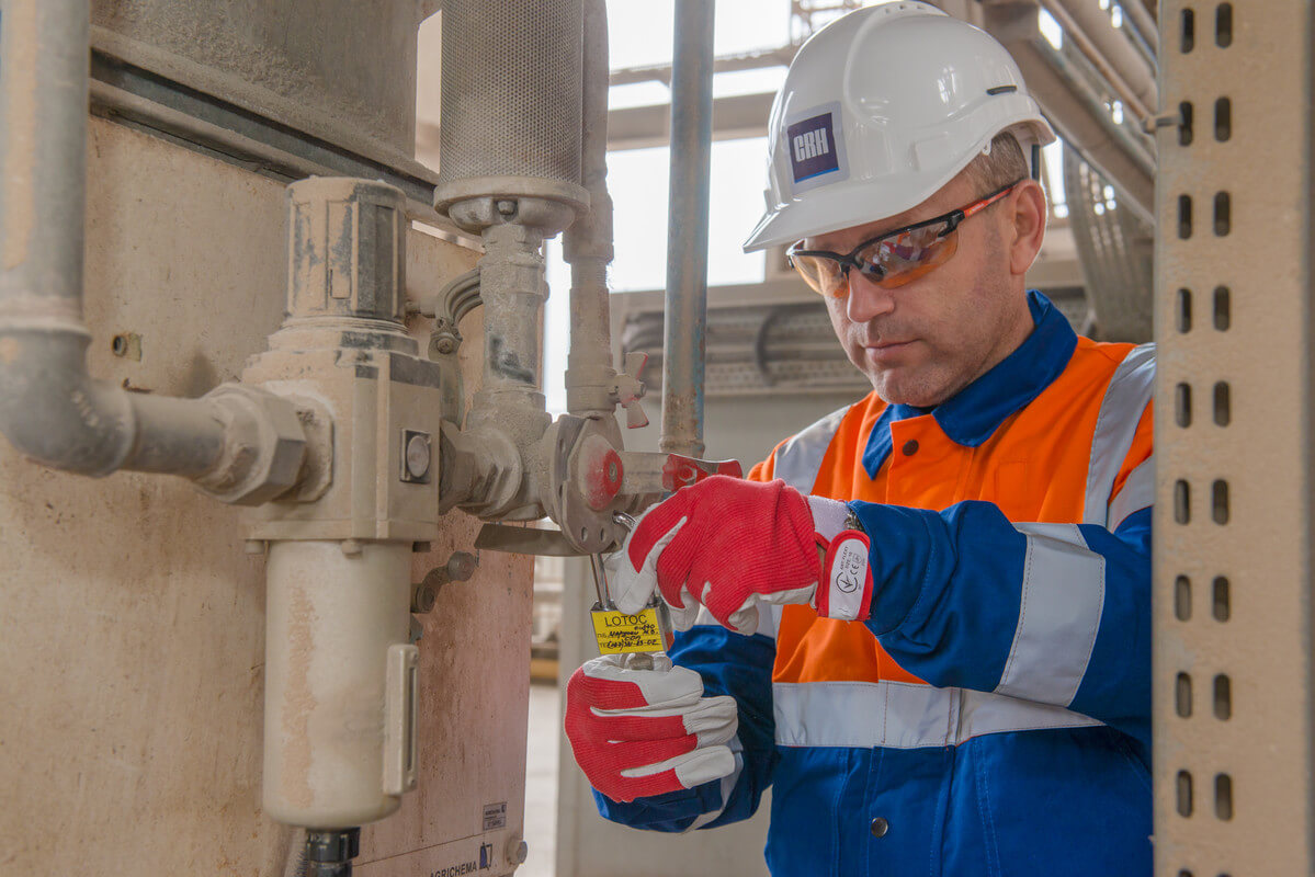 A man performs lockout-tagout inspections